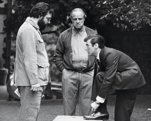pacino-ties-his-shoe-on-set-with-coppola-and-brando