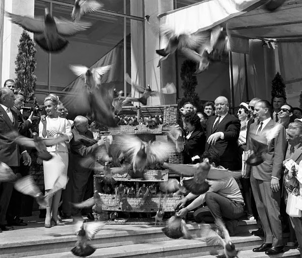 Alfred Hitchcock and Tippi Hedren attend the Cannes Film Festival, 1963.While there they release a bunch of pigeons into the air to promote their film, The Birds