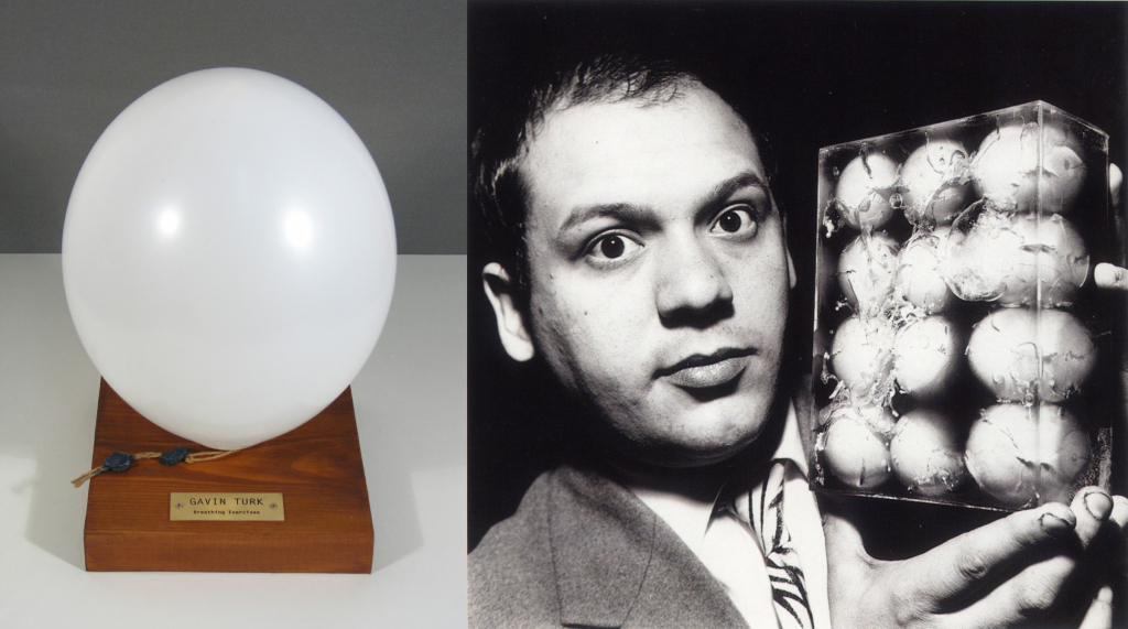 A balloon presented on a small wooden plinth with a plaque reading 'Gavin Turk Breathing Exercise. Artist: Piero Manzoni