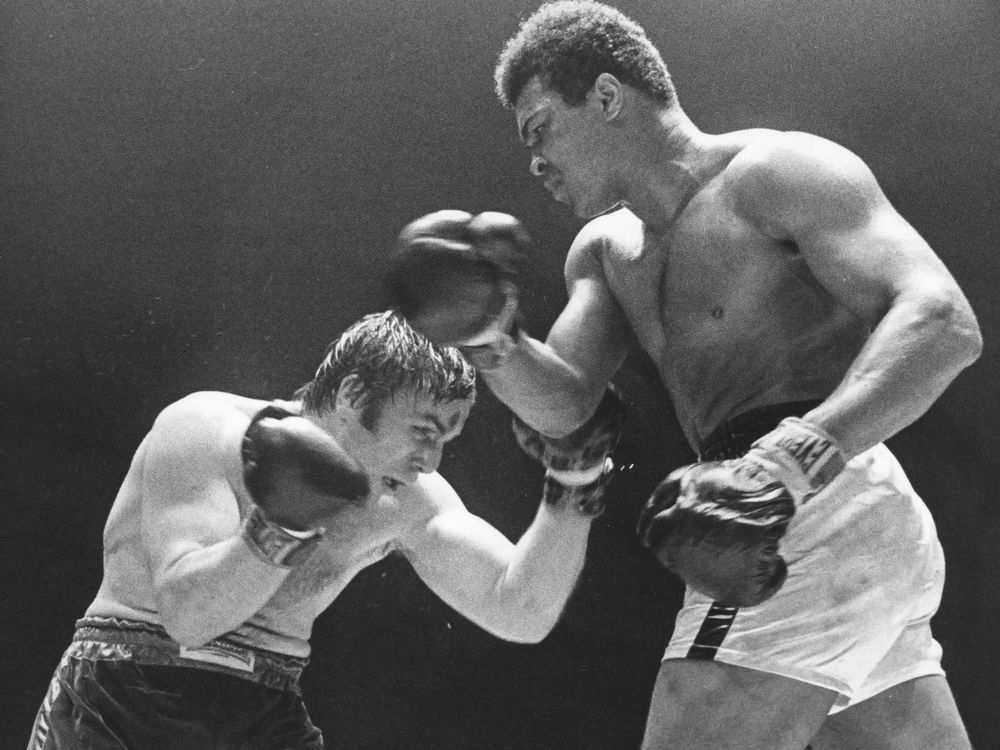 Canadian heavyweight champion George Chuvalo takes on Muhammed Ali in a 12-round bout at Pacific Coliseum in 1972. Ali told Bower that Chuvalo was the toughest challenger he ever fought. Photo by retired Vancouver Sun photographer Ralph Bower, who is having a show at the North Vancouver library. For John Mackie story