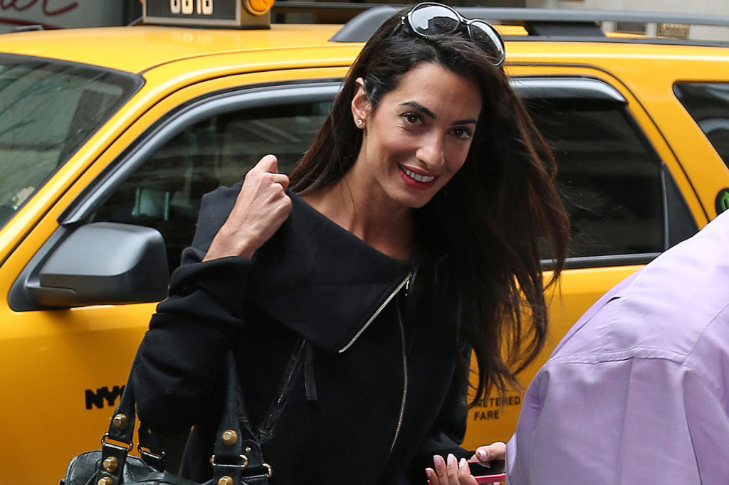 George Clooney's lawyer girlfriend Amal Alamuddin checks out of there hotel leaves separately in New York City.
